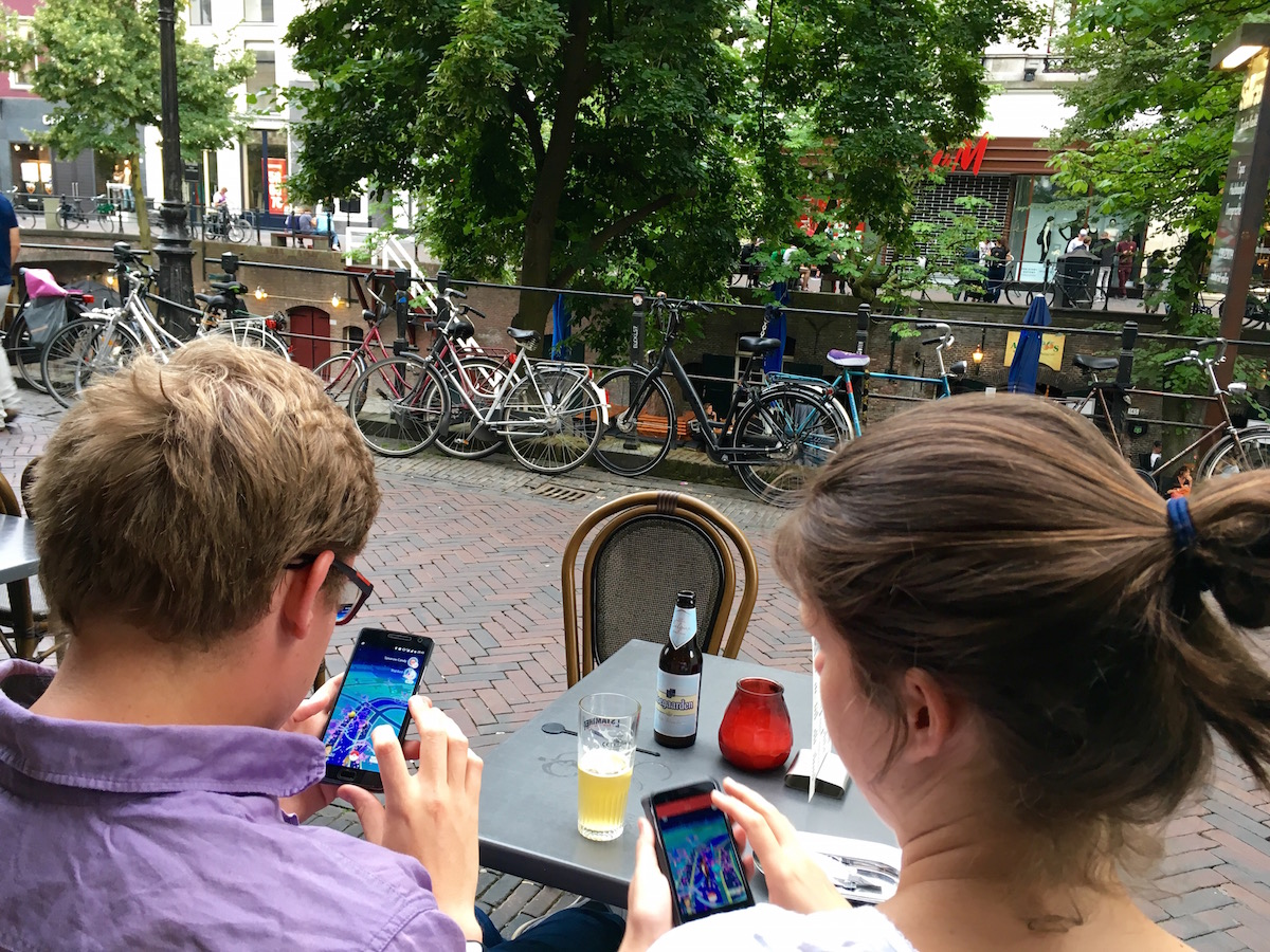 restaurant couple in Utrecht, Netherlands play over a beer